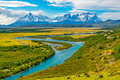 Majestic landscape of the Torres del Paine national park with the Cuernos del Paine peaks and the Serrano river near Puerto Natales, Patagonia, Chile.