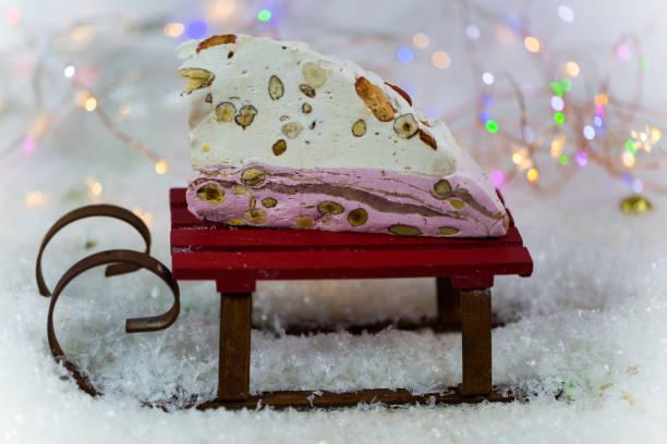Torrone on Christmas, Torrone Torrone on sled stock photo