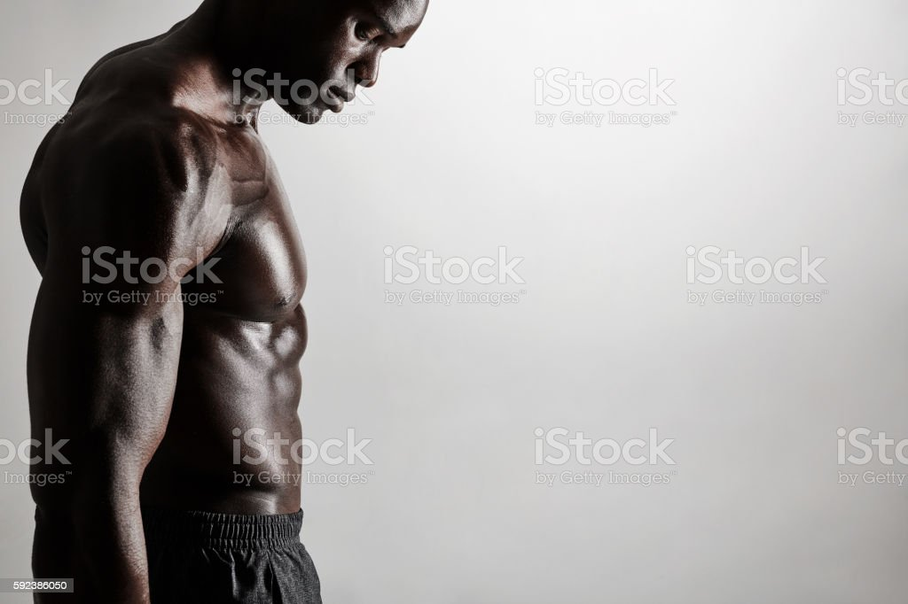 Torso of a muscular man with copyspace stock photo