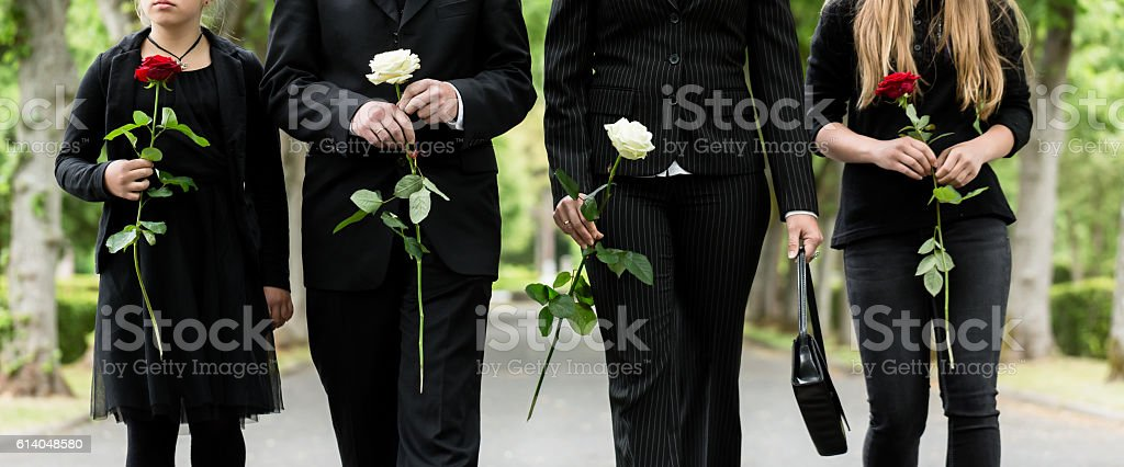Torso of family on cemetery mourning stock photo
