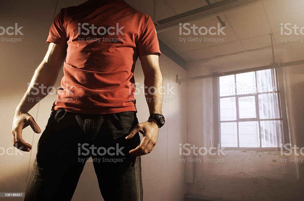 Torso of Man in Empty Warehouse royalty-free stock photo