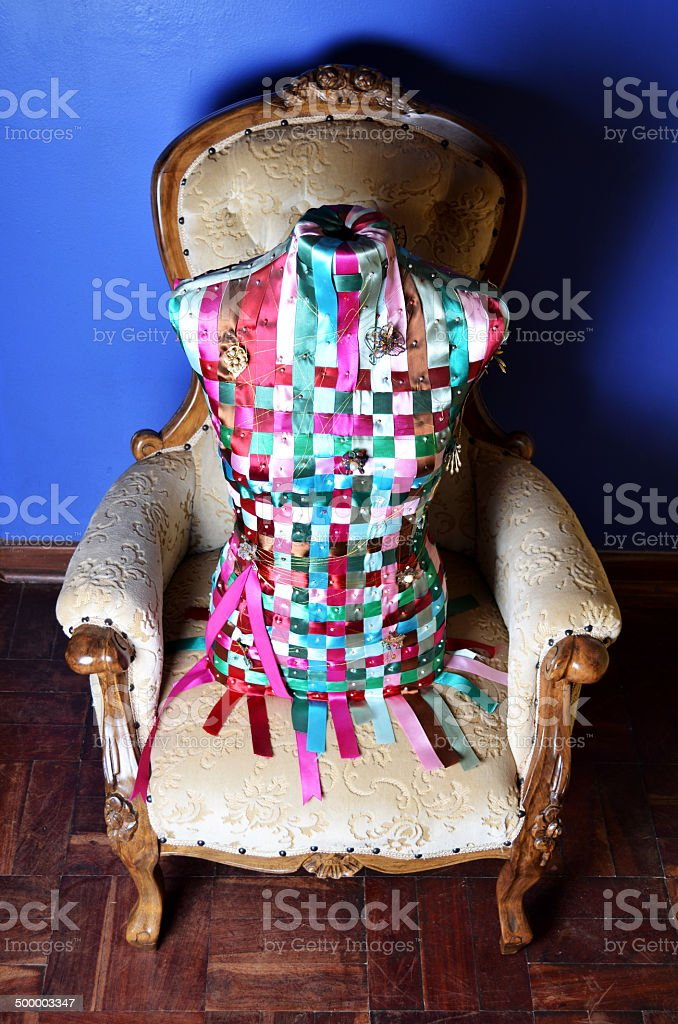 Torso on a chair stock photo