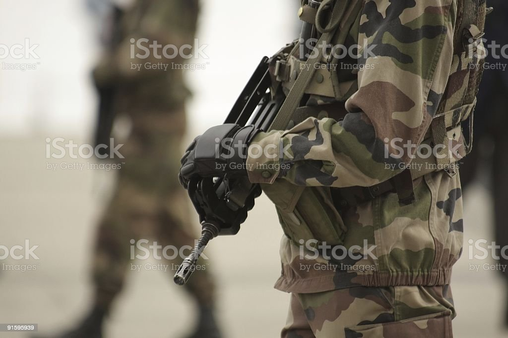 Torso shot of 2 men dressed in army uniform with guns royalty-free stock photo
