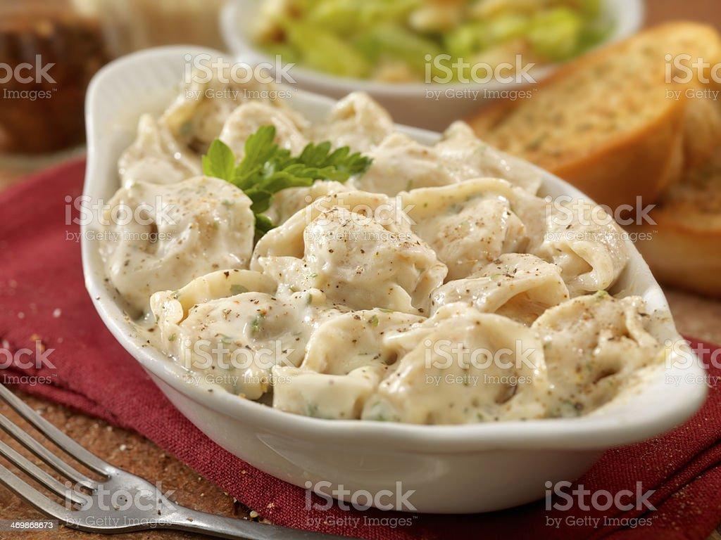 Tortellini in Alfredo Sauce stock photo