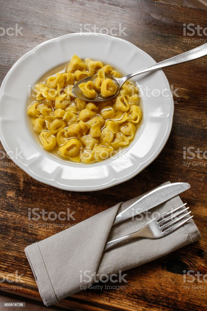 Tortellini with broth. Typical homemade fresh stuffed pasta cooked in broth. stock photo