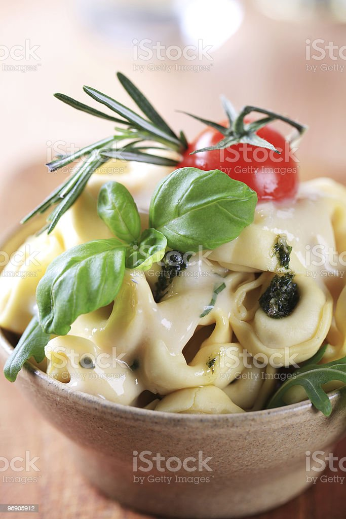 Tortellini with cheese sauce and arugula royalty-free stock photo