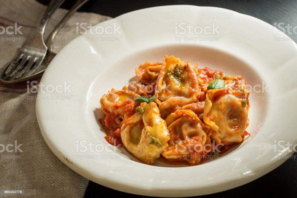 Tortellini with Homemade Tomato Sauce and Mozzarella Cheese royalty-free stock photo