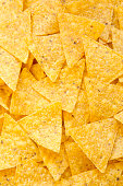 istock Tortilla chips, closeup. Mexican food. Top view, flat lay, overhead. 1018997404