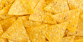 istock Tortilla chips, closeup. Mexican food. Top view, flat lay, overhead. 1082350134