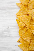 istock Tortilla chips on white wooden background, overhead view. Mexican food. 1020181778
