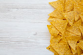 istock Tortilla chips on white wooden table, top view. Mexican food. Copy space. 1020181814