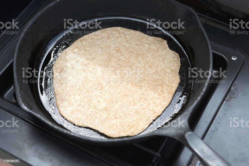 Tortilla Cooking in Frying Pan on Outdoor Stove royalty-free stock photo