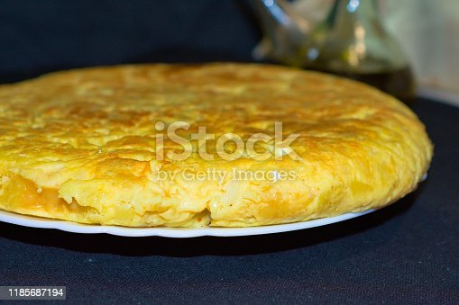 tortilla de patatas with olive oil in the background
