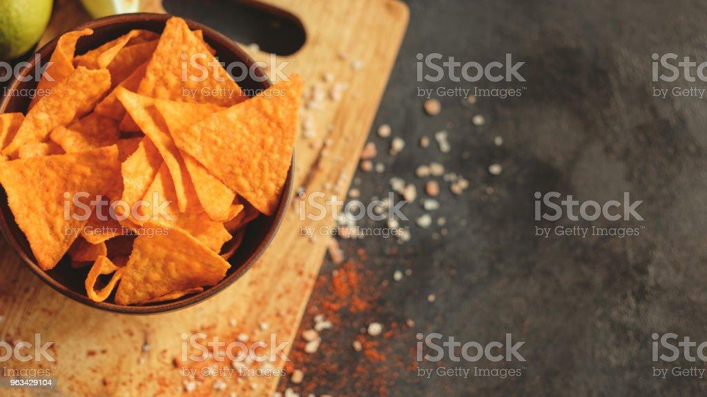 tortilla nacho chips food background crisp slices - Zbiór zdjęć royalty-free (Bez ludzi)