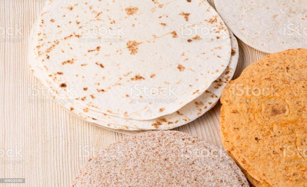 tortilla  on wooden table stock photo