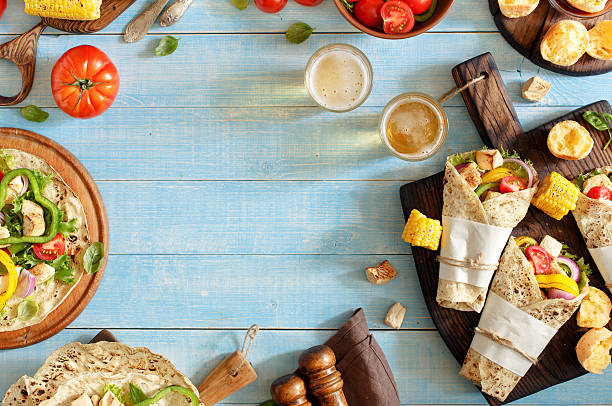 Tortilla with grilled chicken fillet, beer and vegetables stock photo
