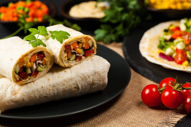 tortilla with vegetables and hummus with chickpeas. - xaile imagens e fotografias de stock