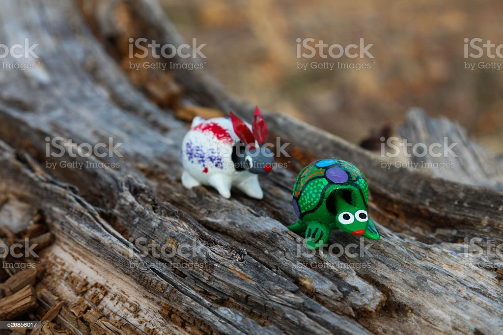 Tortoise in front of the hare, wooden bobble head toys stock photo