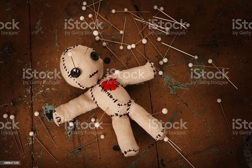 Torture of a Voodoo Doll stock photo