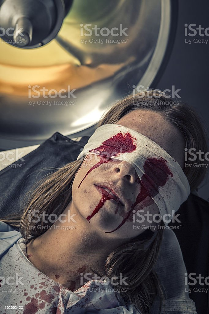 Torture Victim in shock from loosing eyes stock photo
