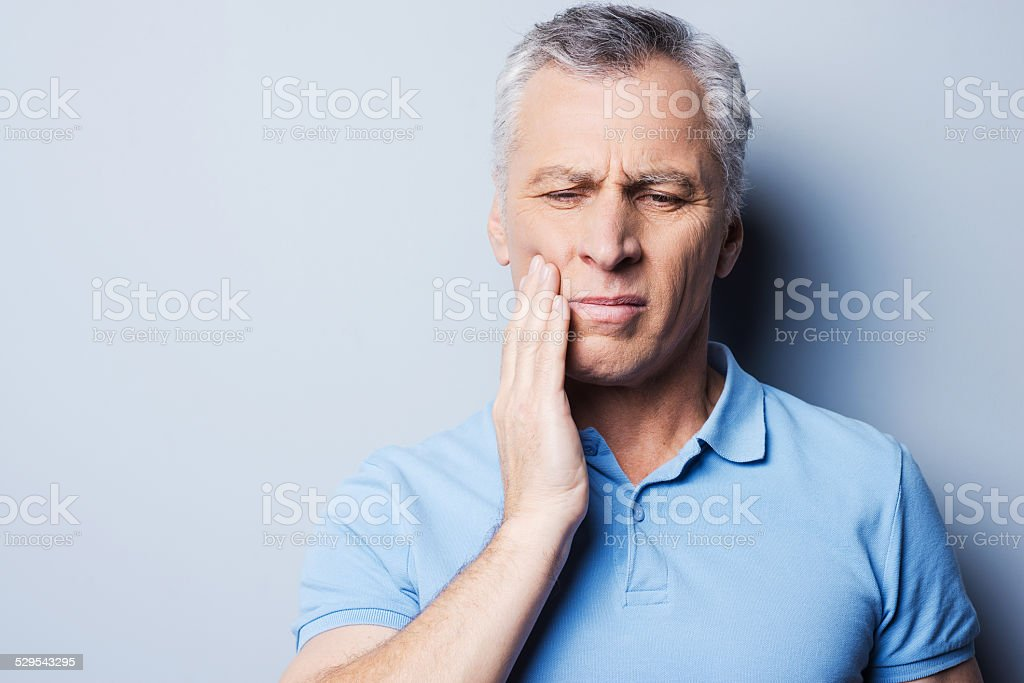 Torturing pain. stock photo
