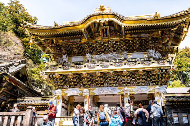 Toshogu temple entrance to shrine Yomeimon gate in Tochigi prefecture in spring with people stock photo