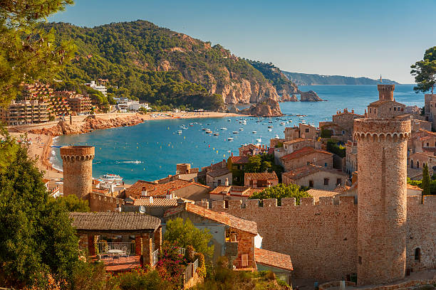 Tossa de Mar on the Costa Brava, Catalunya, Spain Aerial view of Fortress Vila Vella and Badia de Tossa bay at summer in Tossa de Mar on Costa Brava, Catalunya, Spain barcelona spain stock pictures, royalty-free photos & images