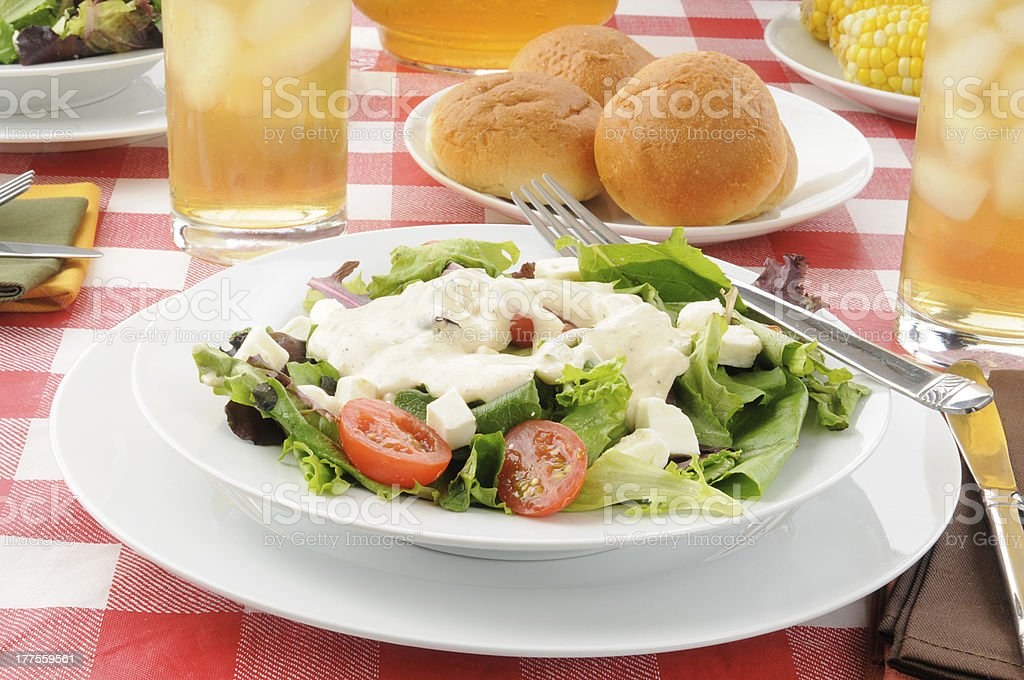 Tossed salad with ranch dressing stock photo