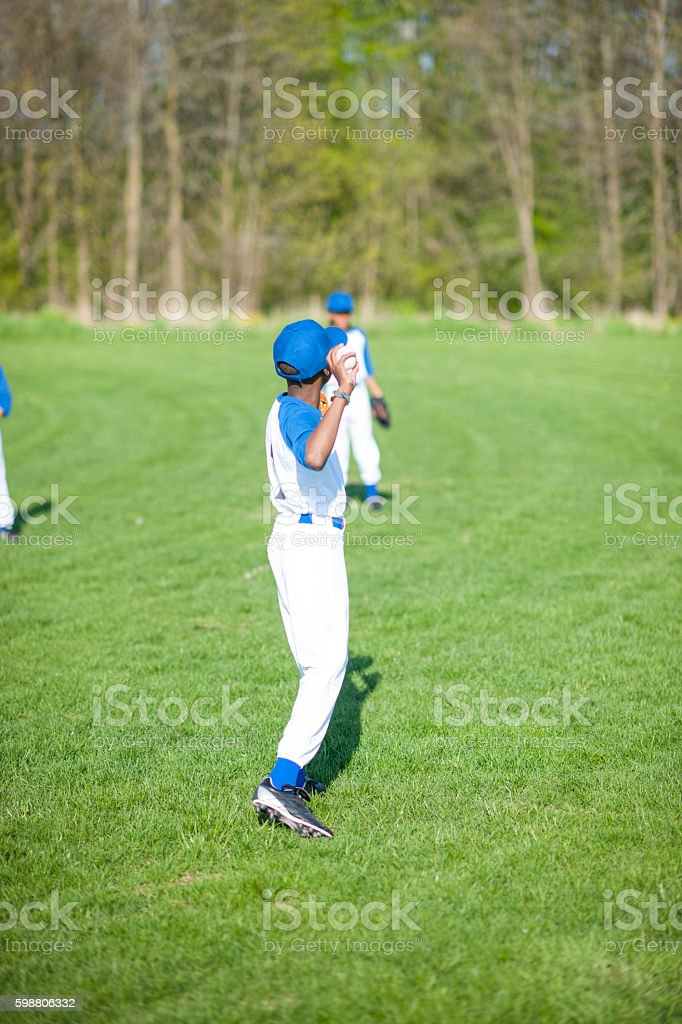 Tossing a Ball at the Park stock photo