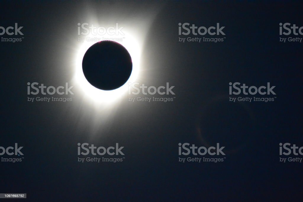 Total eclipse across USA showing mercury as small pale dot.