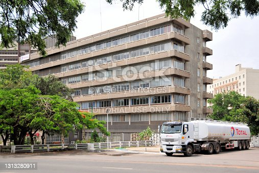 Accra, Ghana: tanker truck and Total House, the HQ of Total Ghana, branch of the French multinational oil and gas company, one of the seven Supermajor oil companies - Accra business district