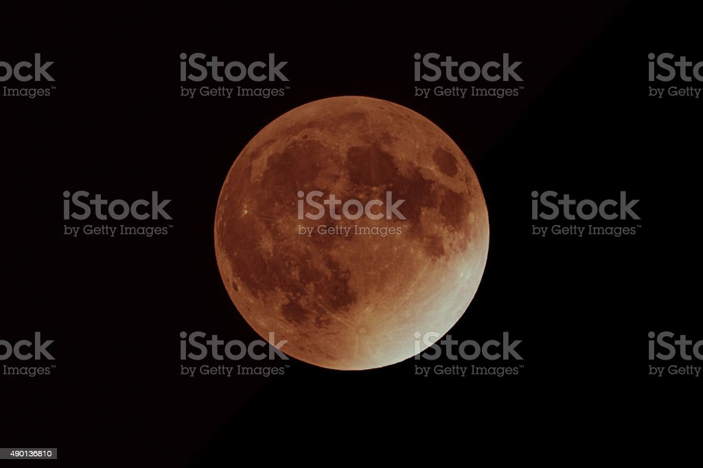 Picture of the Supermoon during a total lunar eclipse. The color of...