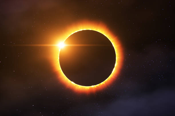 Total Solar Eclipse Picture of a total solar eclipse combined with stars and some clouds. Prefectly usable for all media coverage concerning solar eclipses or astronomy in general. 2017 stock pictures, royalty-free photos & images
