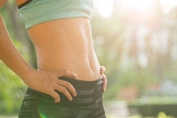 Totally fit Close-up of fit female abdomen abdominal muscle stock pictures, royalty-free photos & images