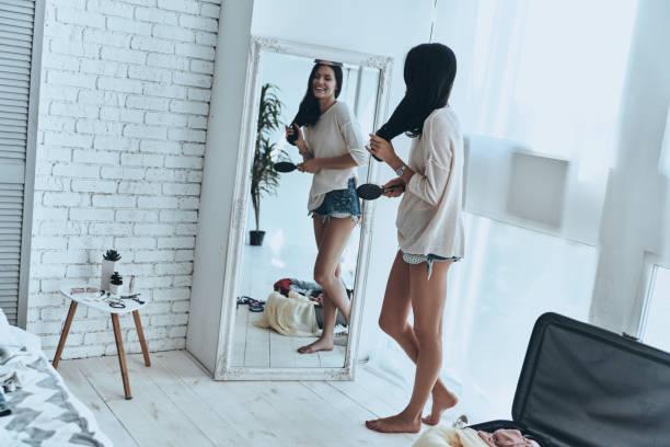totally ready. - woman mirror foto e immagini stock