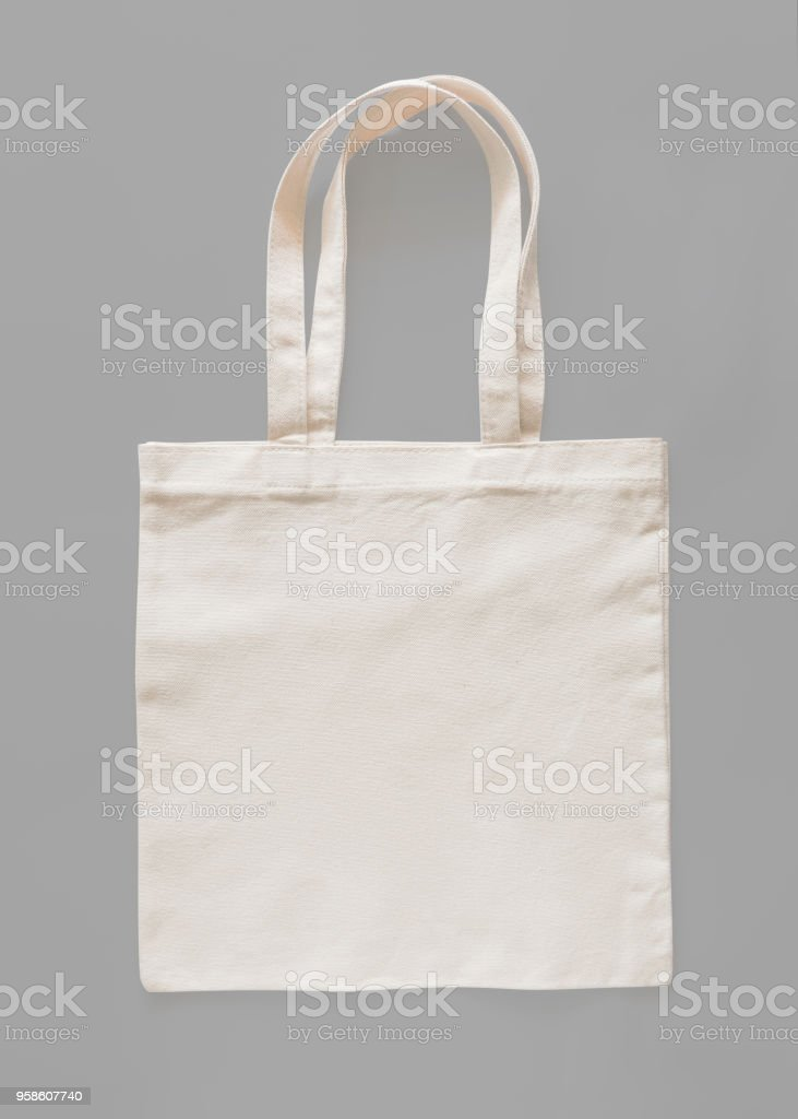 Tote bag canvas fabric cloth eco shopping sack mockup blank template isolated on grey background (clipping path) stock photo
