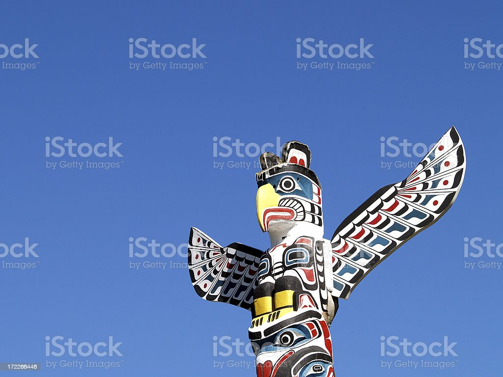 Totem against blue sky stock photo