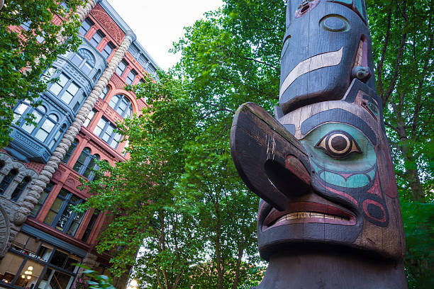 Totem pole at Pioneer Square in Seattle, WA stock photo