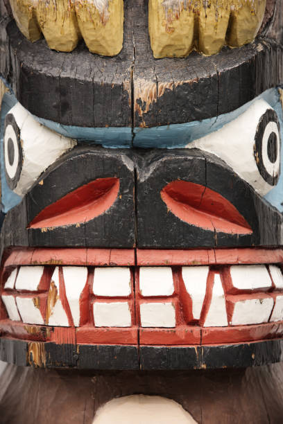 Totem Pole Bear Face Carved Tribal Crest stock photo