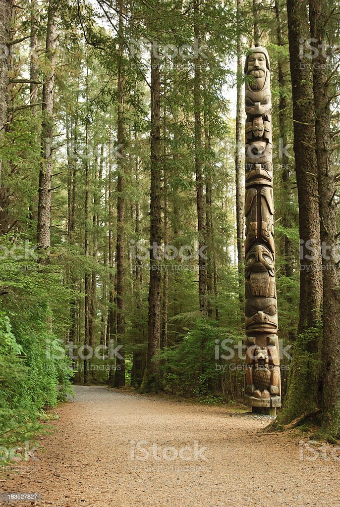 Totem Pole in woods stock photo