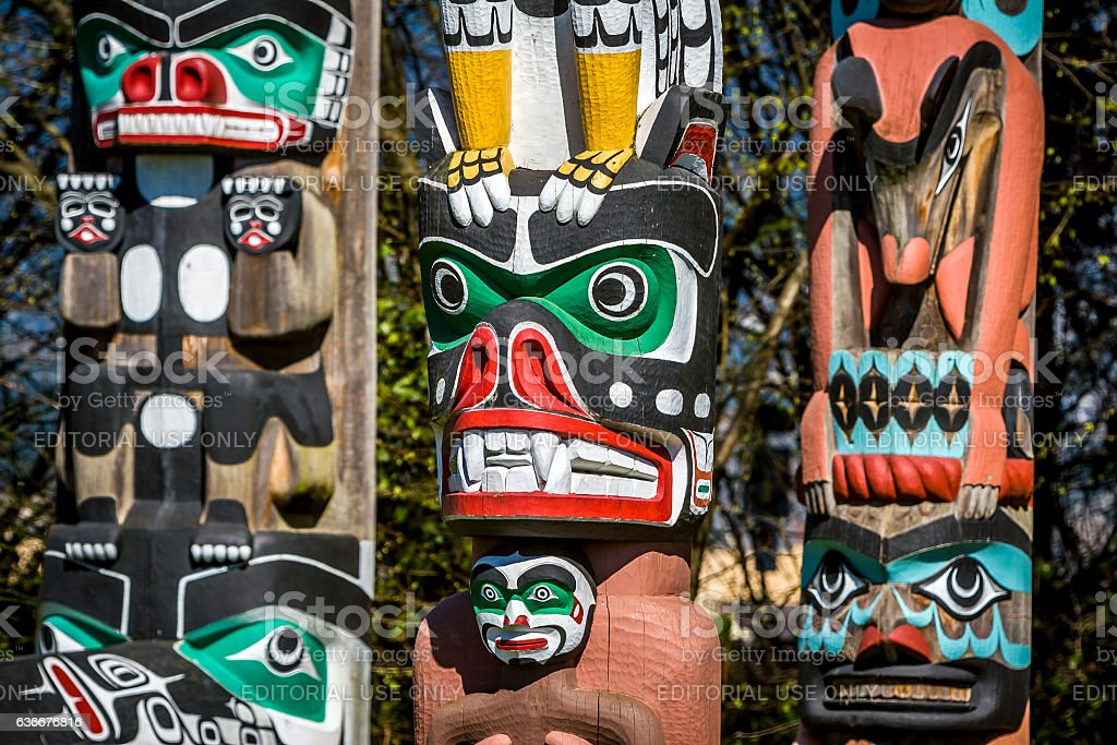 Totem poles in Stanley park, Vancouver. stock photo