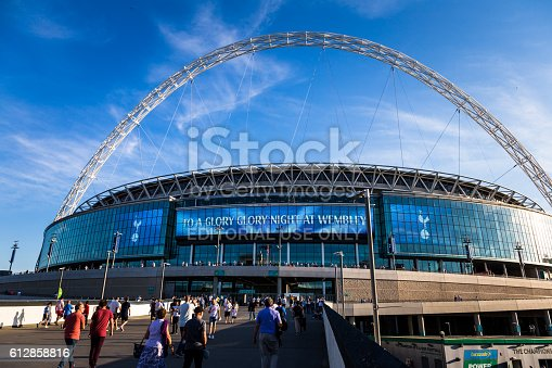 London, UK - September 14, 2016: supporters of Tottenham Hotspur FC wait outside Wembley Stadium (the national stadium of England) in preparation for their team's Champions League match versus Monaco. Many of the fans are decked out in Tottenham's famous white kit.