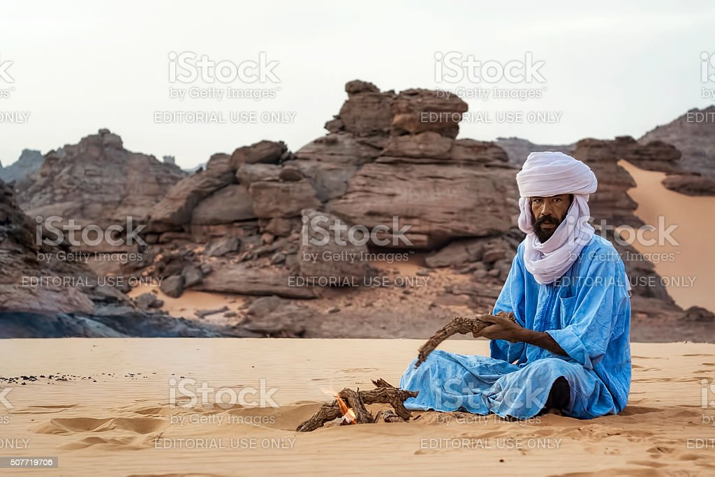 Touareg makes a campfire in the Akakus Mountains, Libya desert stock photo
