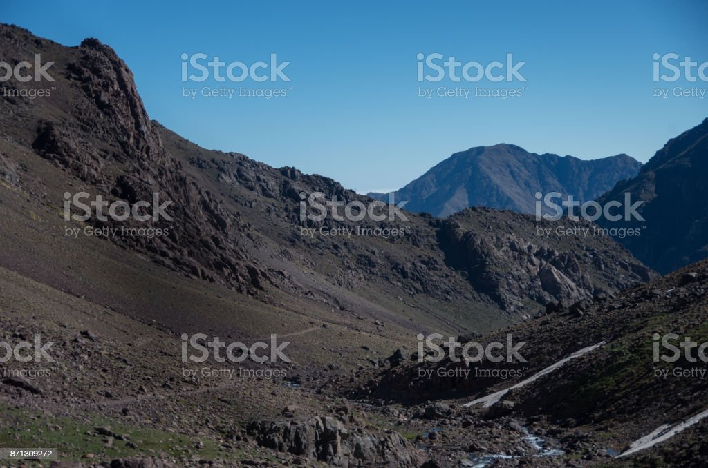 Toubkal national park in springtime. Valley near Refuge Toubkal, start point for hike to Jebel Toubkal, – highest peak of Atlas mountains and Morocco stock photo