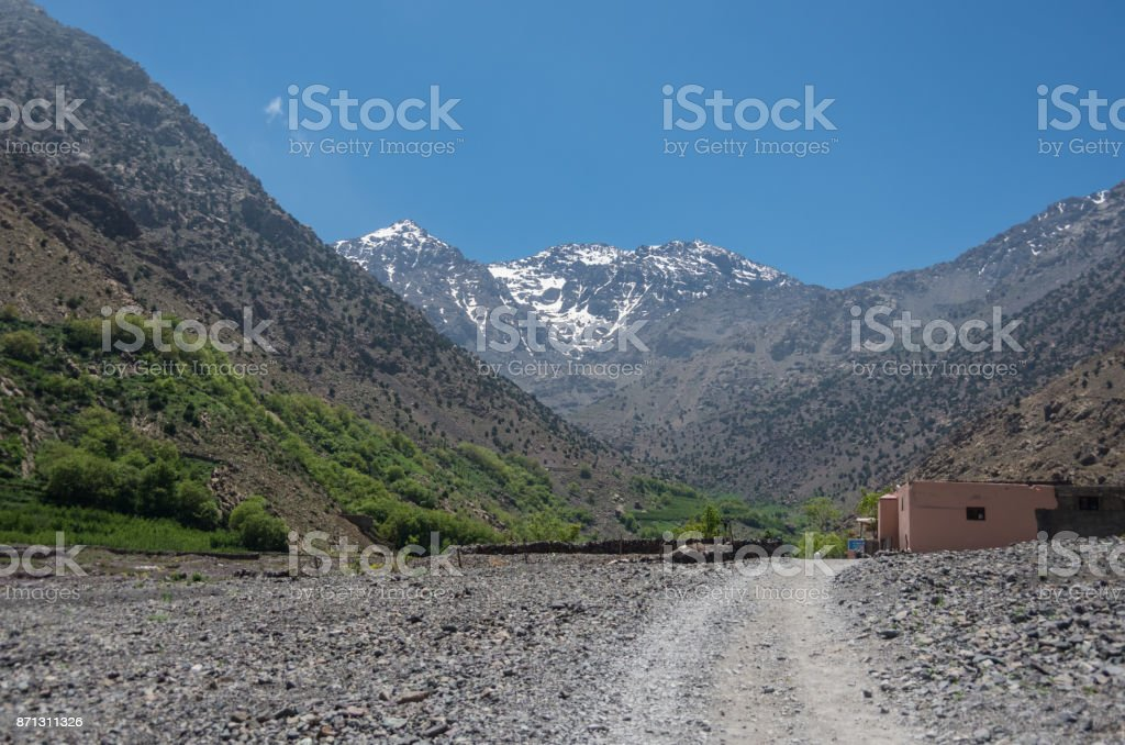 Toubkal national park in springtime with mount, cover by snow and ice, valley near Aroumd town, l, start point for hike to Jebel Toubkal, highest peak of Atlas mountains and Morocco stock photo