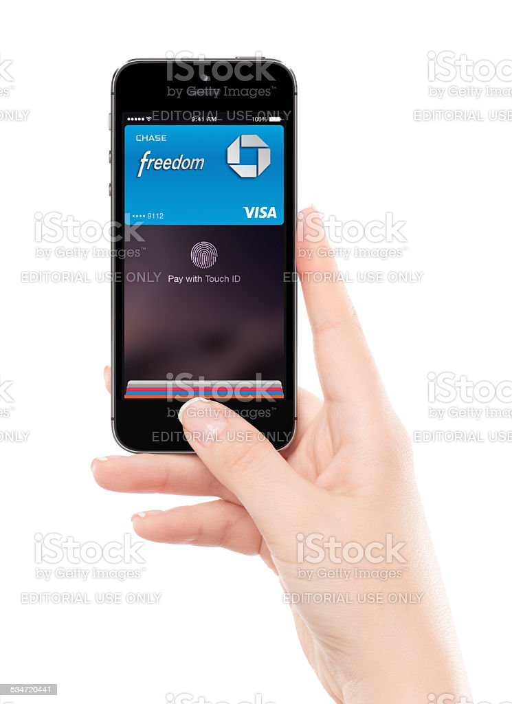 Touch id ApplePay technology in Apple Space Gray iPhone 5S stock photo