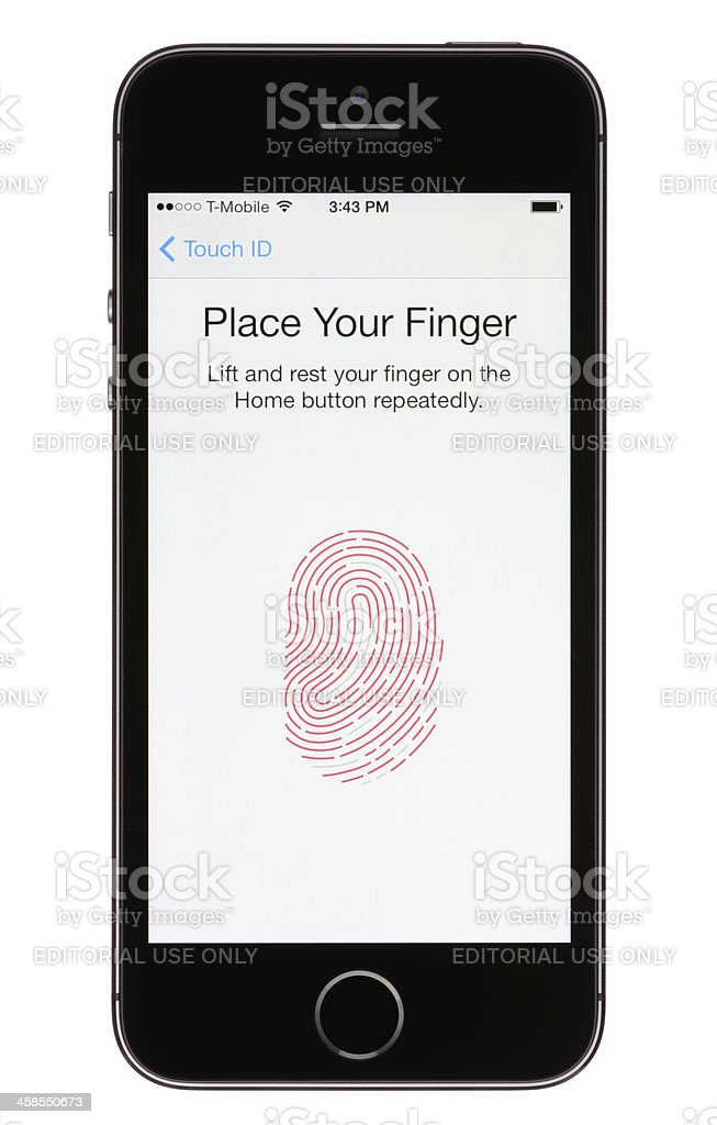Touch ID on an Apple iPhone 5s stock photo
