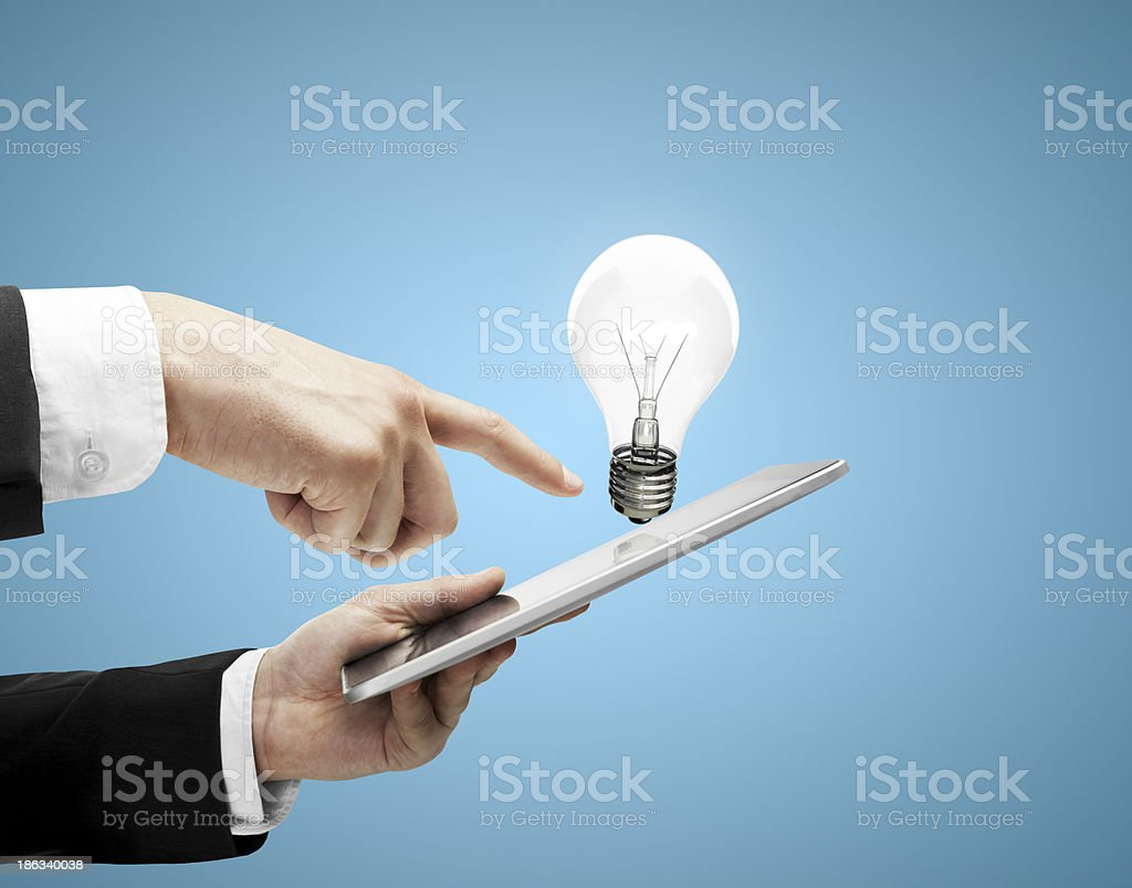 touch pad and bulb royalty-free stock photo