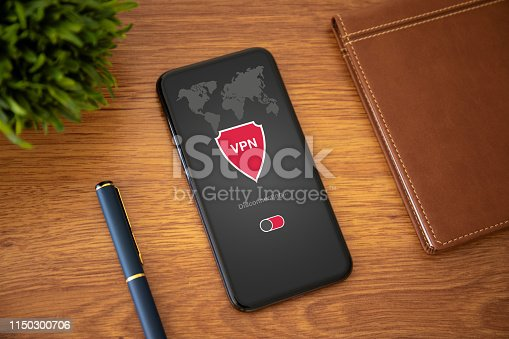 touch phone with app vpn creation Internet protocols for protection private network on a yellow office table