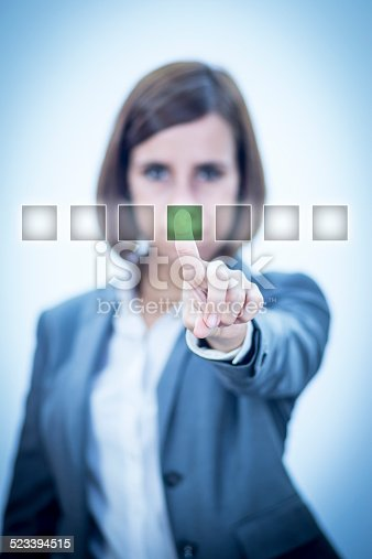 515789546istockphoto Touch Screen con virtual green button 523394515